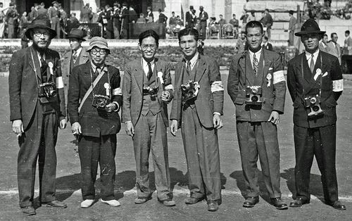 Photographers at the Syngman Rhee celebration during October 1945 in Seoul. Cameras are Super Ikonta B's and Leica's. ( I took the photo with a Signal Corps Leica and scanned an 8x10 print. Several rolls of 35mm film were stolen from me while in Korea.)