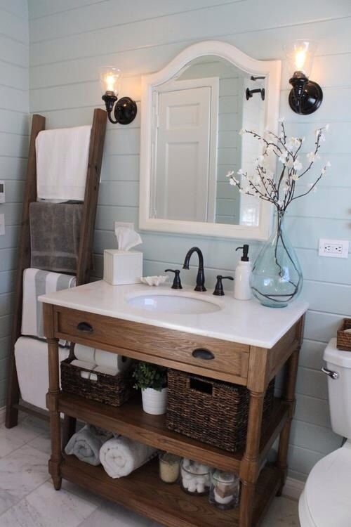 "Benjamin Moore Palladian Blue walls. Love the shelf space under the sink and the ""ladder"" towel rack."