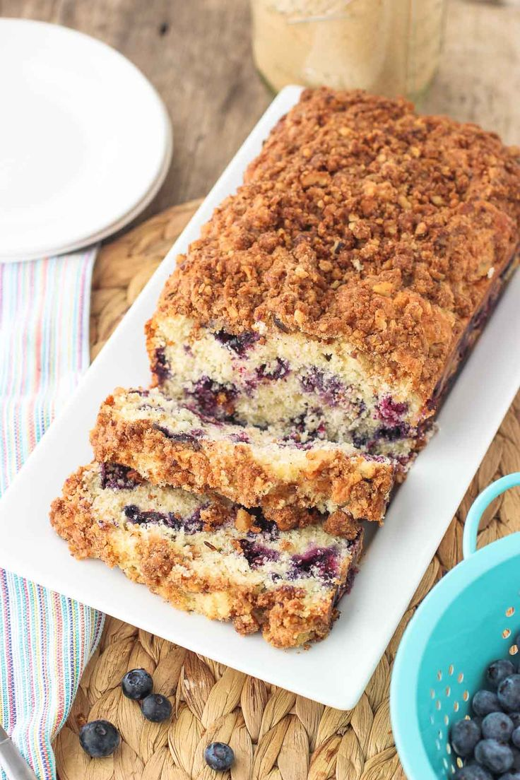 Blueberry Muffin Bread - a quick bread packed with juicy blueberries and topped with walnut cinnamon streusel. mysequinedlife.com