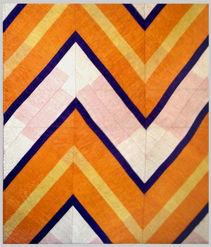 Antique uzbek handwoven silk IKAT fragment. Uzbekistan 1920.  Measurement: 18inches x 22inches.  Esther Fitzgerald Rare Textiles.