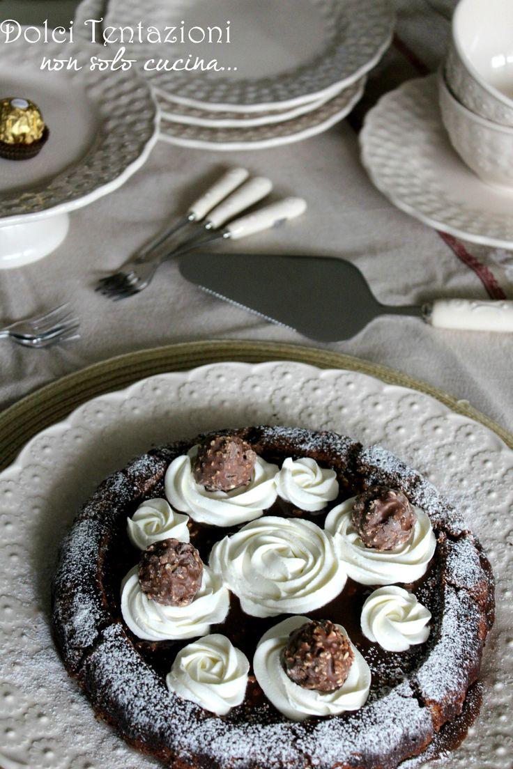 Tanto golosa quanto bella da vedere, la Crostata morbida al cioccolato è un dolce calorico da concedersi ogni tanto, ricetta semplice da preparare.  http://blog.giallozafferano.it/dolcitentazionidirdc/crostata-morbida-al-cioccolato/