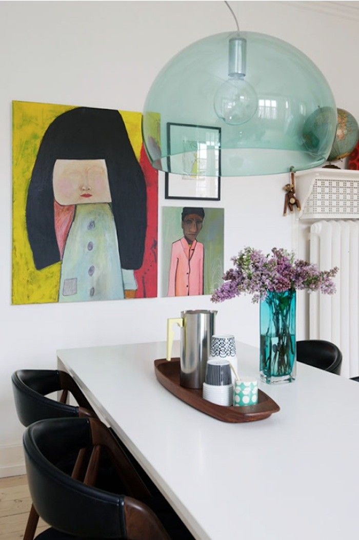 Anne Mette Skodbor, Copenhagen home, Paintings in dining area, clear green glass pendant shade  | Remodelista