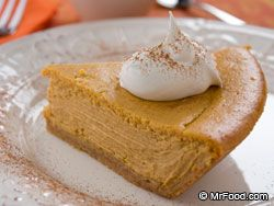 Easy Pumpkin Cheesecake - We've take the traditional pumpkin pie to the next level with a smooth 'n' velvety cheesecake texture—the perfect fall dessert.