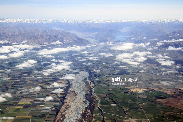I was on my way flying from Wellington to Queenstown when my plane flew across Waitaki River which runs between Canterbury and Otago Region from the Southern Alps. You can see the snow capped Southern Alps lining left to right on the background of this picture.