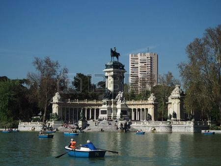 people in nacelles in the lagoon of park of Retiro.