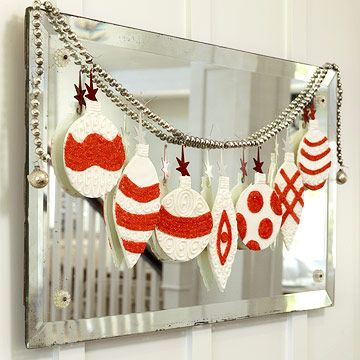 Trace ornament shapes onto cardstock, felt, or foam board. Embellish each ornament with stripes or polka dots and glitter. Attach handmade ornaments to a silver cord (found at a crafts store) and hang from a mirror.