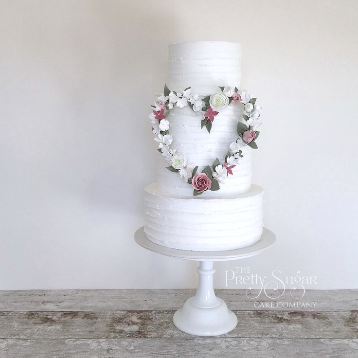 Rustic icing with sugar flowers heart wreath. Shabby chic
