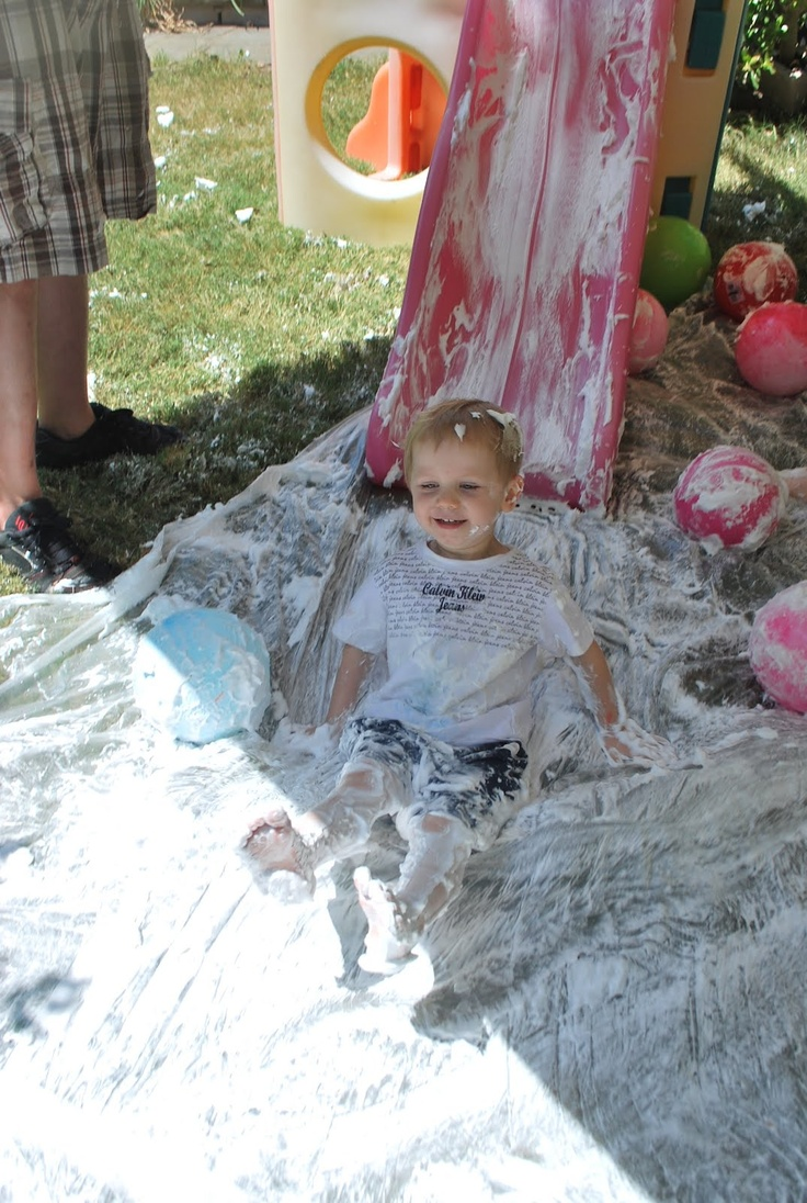A Messy Party with all sorts of stations. This shaving cream slide plus dirt pit, splatter painting, slime, etc. This looks like so much fun!!!
