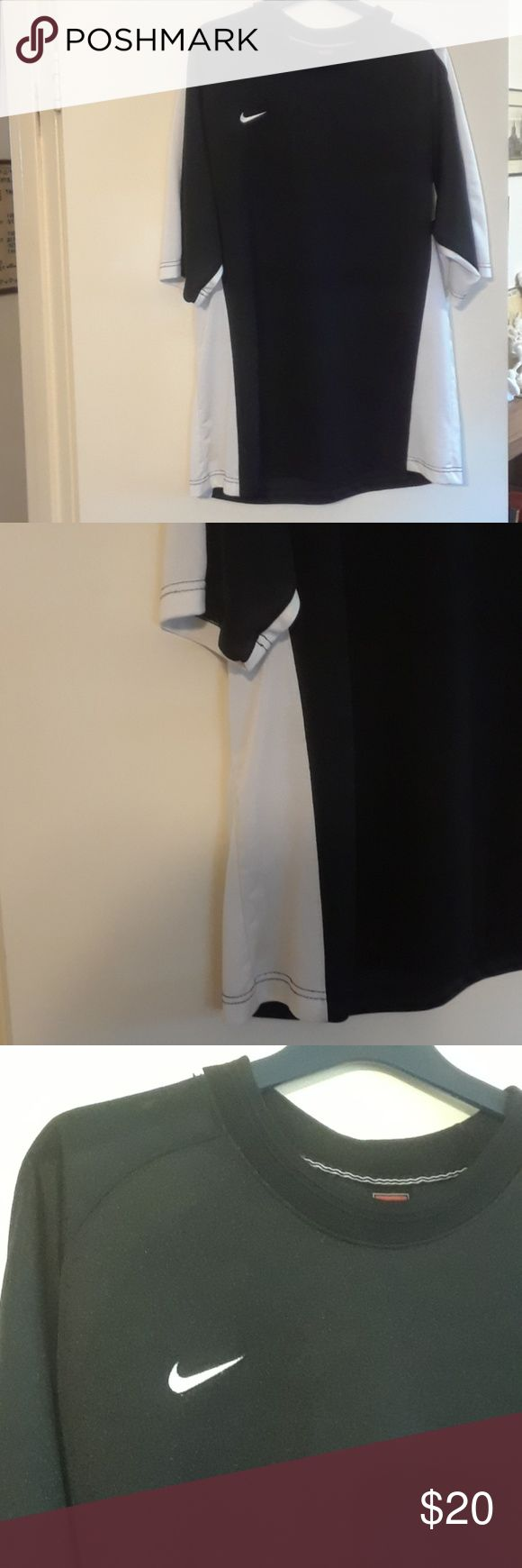 Men's Nike Workout Shirt Black with white stripe down both sides and on sleeves.  Excellent condition with one small pick on back of right sleeve. From smoke free home. Nike Shirts