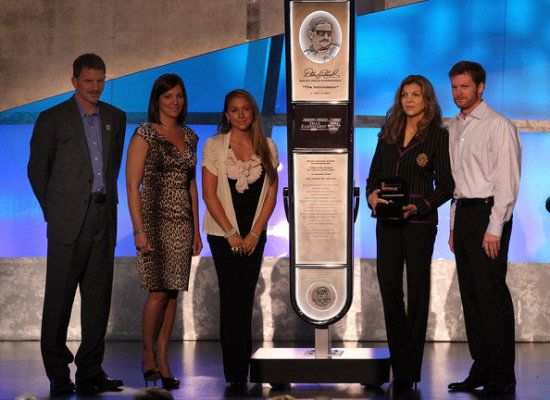 Driver Dale Earnhardt Jr. (C) speaks as (L-R) Teresa Earnhardt, Kerry Earnhardt, Kelley Earnhardt Elledge and Taylor Earnhardt stand on stage as Dale Earnhardt Sr. gets inducted into the 2010 NASCAR Hall of Fame Induction Ceremony at the Charlotte Convention Center on May 23, 2010 in Charlotte, North Carolina.  #NascarhallofFame
