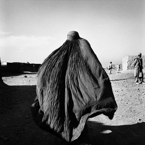 © Stephen Dupont 'Burqua Lady' Shamsatoo Refugee Camp Peshawar, Pakistan, 2001 Edition: 3/15, $3,000 unframed, $3,300 framed. Medium: Silver Gelatin Print  Printed 2010 by Chris Reid All prices are inclusive of a Goods & Services Tax (GST)