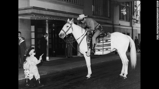 two small boys hold up the Lone Ranger on July 21, 1958. (Oh,how fun!!!)