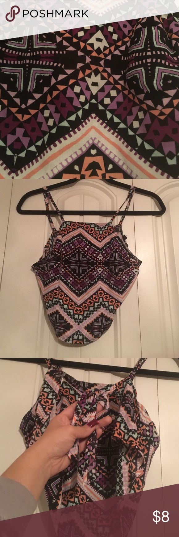 TRIBAL BAREBACK CROP TOP Tribal has been and is still the trend! This cute top was bought at Express. Tribal crop top with only a string to tie in a bow on the back(bareback)! Sexy, flirty, fun! Size XS Express Tops Crop Tops