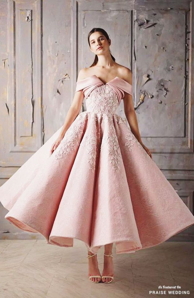 This fashion-forward satin gown from Mark Bumgarner featuring floral embroideries and an unique off-the-shoulder design is oh so chic! » Praise Wedding Community