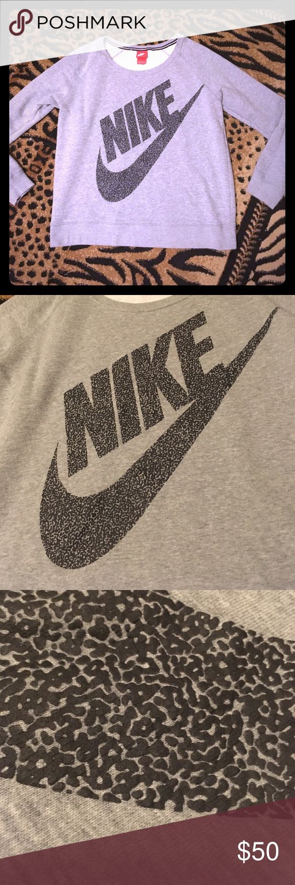 Nike leopard print sweatshirt Gray Nike sweatshirt. With black cheetah leopard print logo. Rare. Gently used. Good condition! Nike Tops Sweatshirts & Hoodies