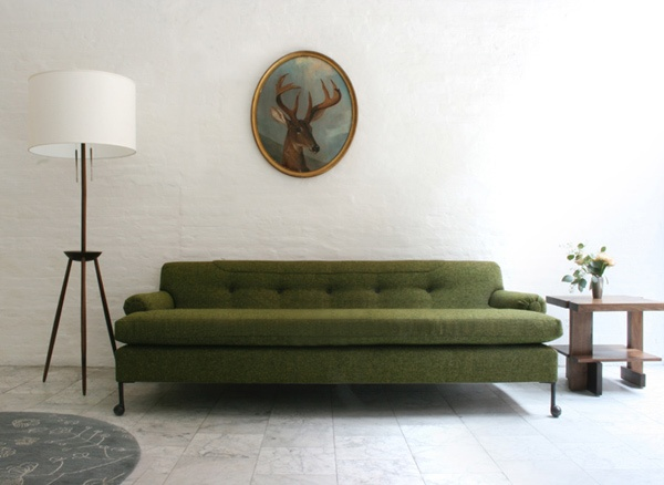 a bit too minimalist for me, but i like the color combo. {white lamp, dark green couch. grey floor.}