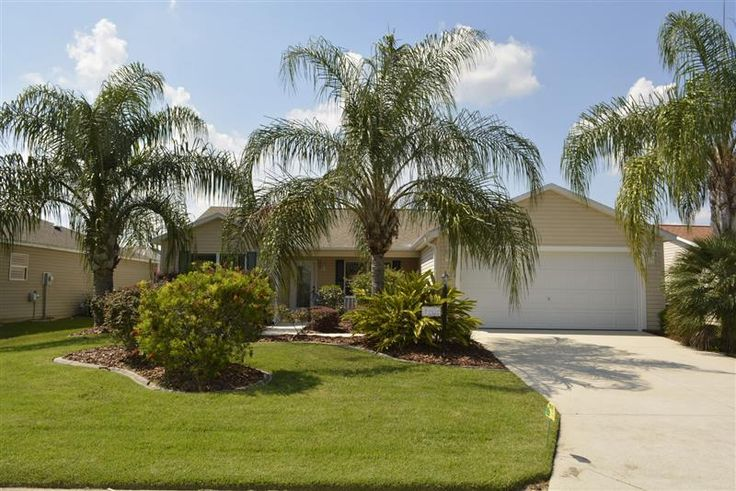Landscaping at The Villages Home. I want to live in a house with Palm Trees in my front yard!