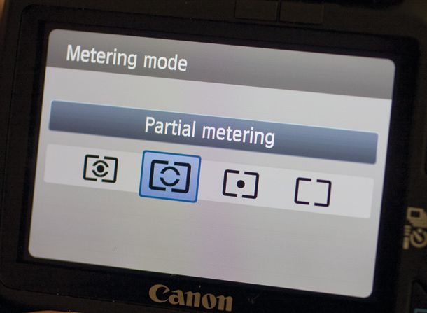 The Metering Mode button on your camera is symbolised by an eye-shaped icon within a rectangle. Within your metering mode function you will have either three or four metering modes: spot metering, partial metering, centre-weighted metering and evaluative metering. As you will see in our latest photography cheat sheet below, each metering option measures the brightness of a scene in different ways, depending on what subject you are shooting.