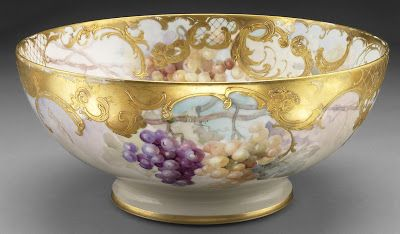 Painted and partial gilded porcelain bowl with painted grapes by Franz Bischoff.