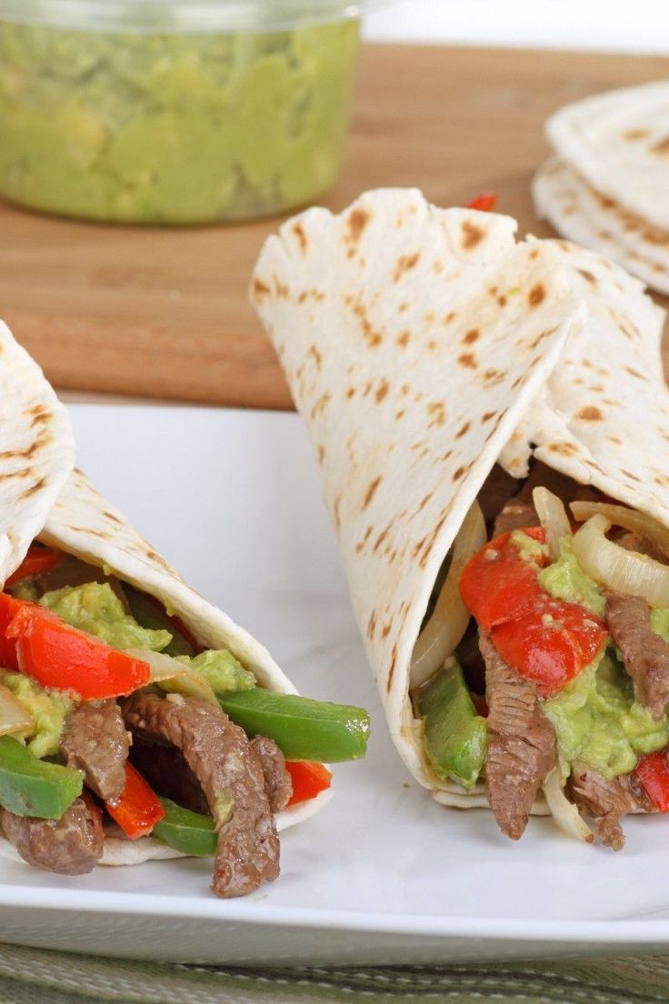 Recipe including course(s): Entrée; and ingredients: bell pepper, black pepper, cheese, chili powder, cumin, flour tortilla, garlic, lime juice, olive oil, onion, red pepper flakes, salsa, salt, sour cream, tomato, top sirloin steak