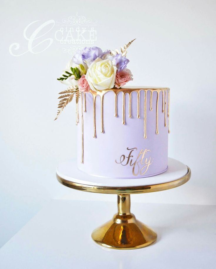 Lilac and gold drippy cake