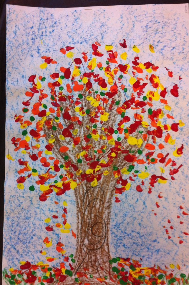 Kindergarten tree project. Hand and arm for trunk with branches. Finger painted leaves in fall colors.