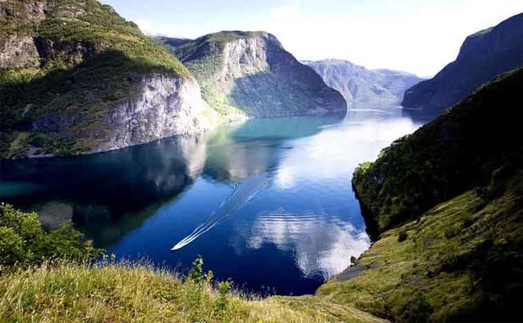Fjord Tours of Norway ; Centuries of glacier movement carve bays into rocky cliffs which offer a great view for sightseers.