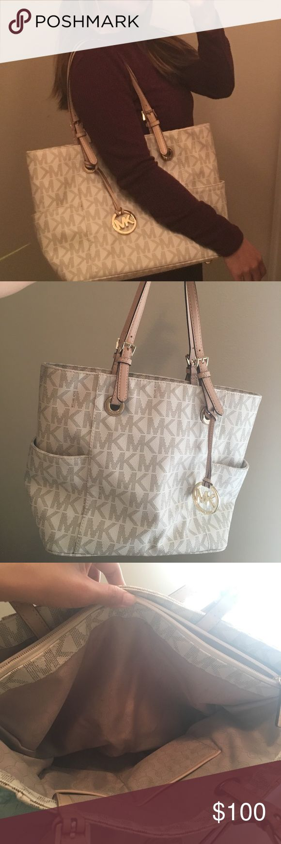 "Michael Kors Logo Handbag Vanilla colored (not white) tote with lots of pockets. All zippers work perfectly. Good condition, has some not very noticeable makeup spots inside, and some wear on the bottom metal ""feet"". Nice and pretty neutral color that goes with lots of outfits. Smoke-free home. Michael Kors Bags Shoulder Bags"