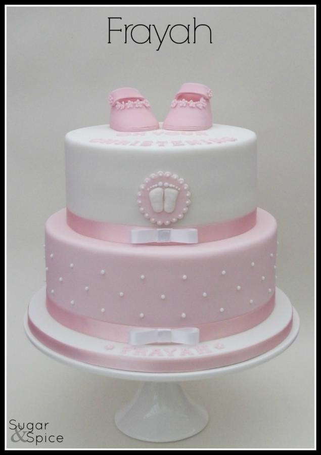 Frayah pink and white christening cake with bootees