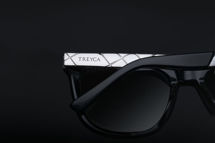 Treyca Wayfarer Sunglasses - Silver with a gloss black frame.