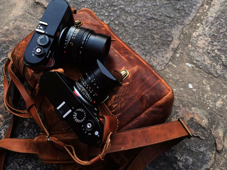 My Travel Essentials in an Ona Brixton bag:  - Leica M with Leicatime case - Leica M9 with Leicatime case - Leica Noctilux 50mm f0.95 - Leica Summilux 35mm f1.4 - Leica Summicron 90mm f2.0 - Leica Super Elmar 18mm f3.8 - Samsung Galaxy EK-GC110  - iPad Air  - Two Leica eyepieces - Two M9 spare batteries - One M spare battery - Two passports (one in a Montblanc passport cover) - Colorright Passport - Filter holder - Cash - thick bundle with fifty currency notes  An amazing bag. I love it.