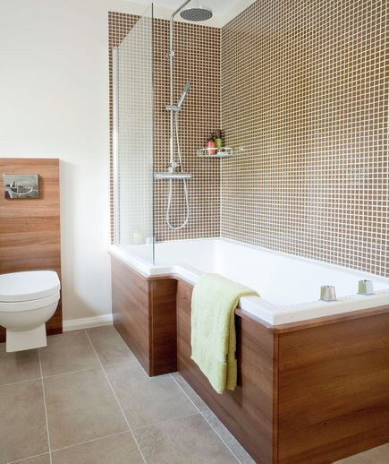 Bathroom with wood accents and shower with brown mosaic tiles.  I like the wooden tub surround.  (Real Simple)