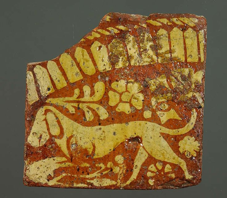 Hunting dog surrounded by flowers.  Medieval floor tile from Whitland Abbey, Wales