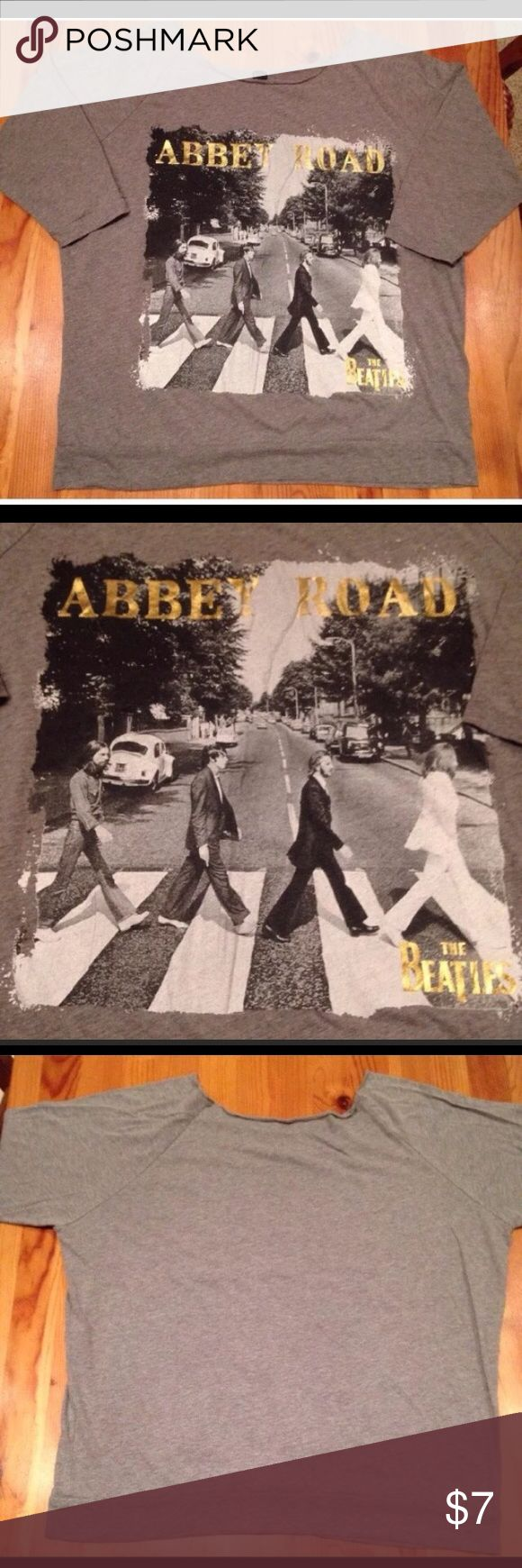 "BEATLES 🎸 ABBEY ROAD T-SHIRT Women's L/XL Pre-owned vintage gray Beatles ""Abbey Road"" t-shirt. Size women's L. Chest: 23"" across lying flat pit to pit. Length: 24.5"". Metallic gold lettering. Material: 60/40 poly/cotton. APPLE CORPS Tops Tees - Short Sleeve"