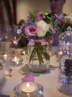 Flowers and candles for beautiful and cheap centerpieces. Lots more here http://www.cheap-wedding-solutions.com/flower-and-candle-centerpiece.html