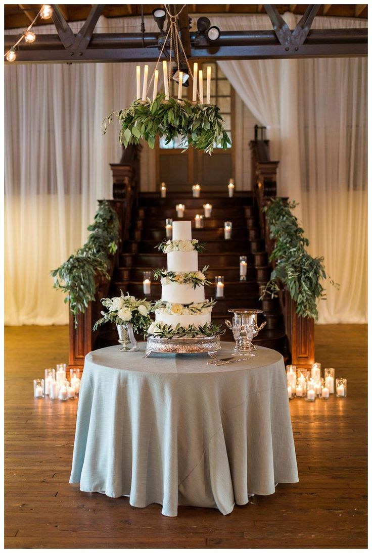 display wedding cake wedding cake display with candles olive leaf garland and 13602