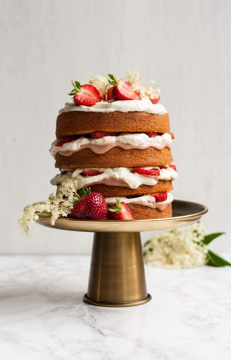 Strawberry and Elderflower Curd Layer Cake - this impressive layer cake is filled with the flavours of summer and is surprisingly easy to make!   eatloveeats.com