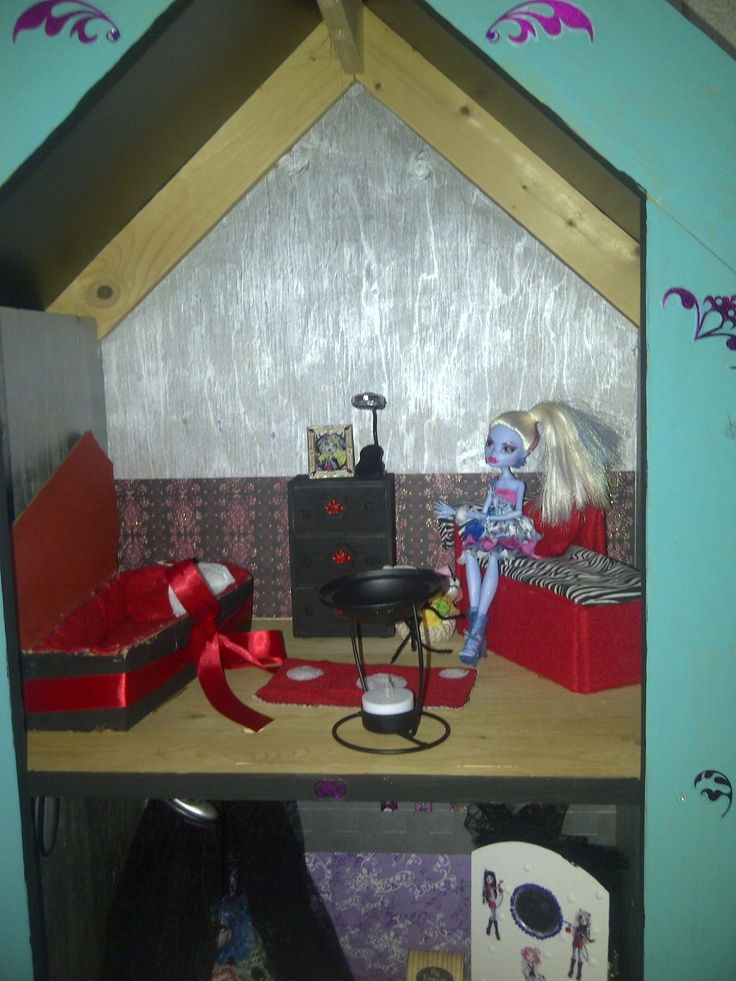 Couch and coffin bed made from cardboard covered with felt and Walmart fabric.  Pained dollar store jewellery box into dresser, book light used as doll lamp