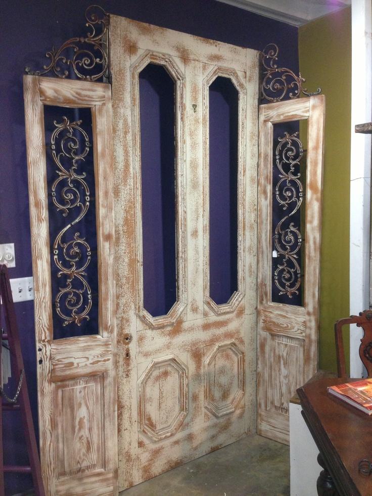 Old Door Repurposed Into A Decorative Room Divider