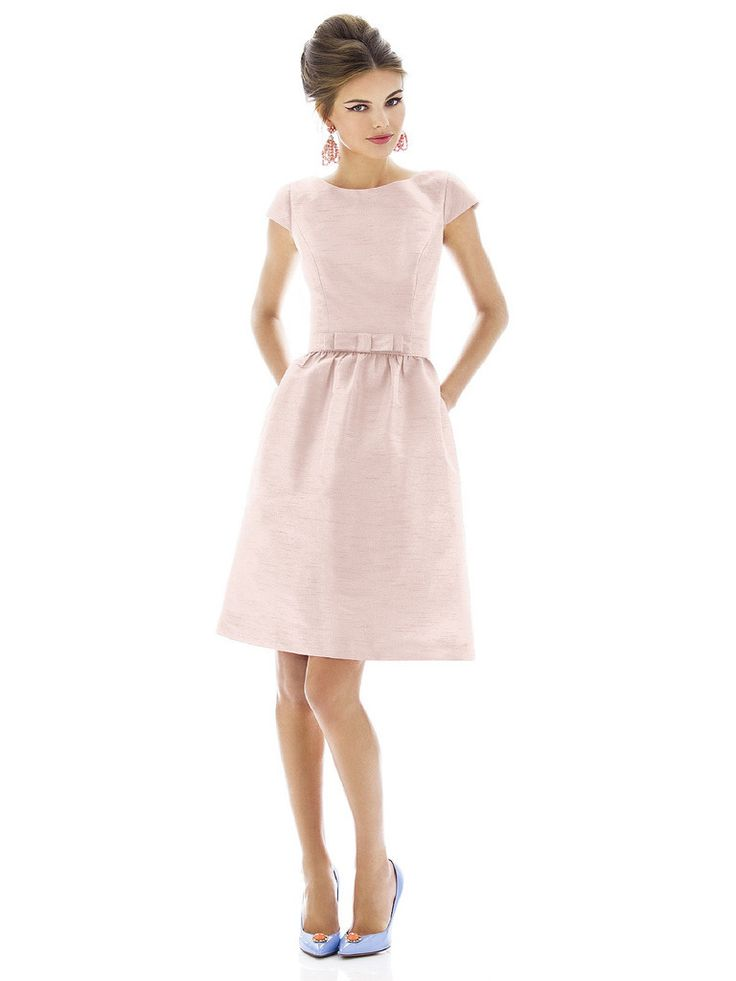 A short Alfred Sung bridesmaid dress with cap sleeves and bateau neckline. Matching belt with flat bow detail of style D568 sits at natural wait. The shirred A-line skirt has pockets at side seams. Hidden zipper and