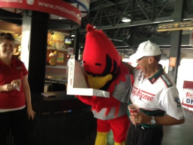 Memphis RedBirds mascot and Ron ~ loving some Krispy Kreme