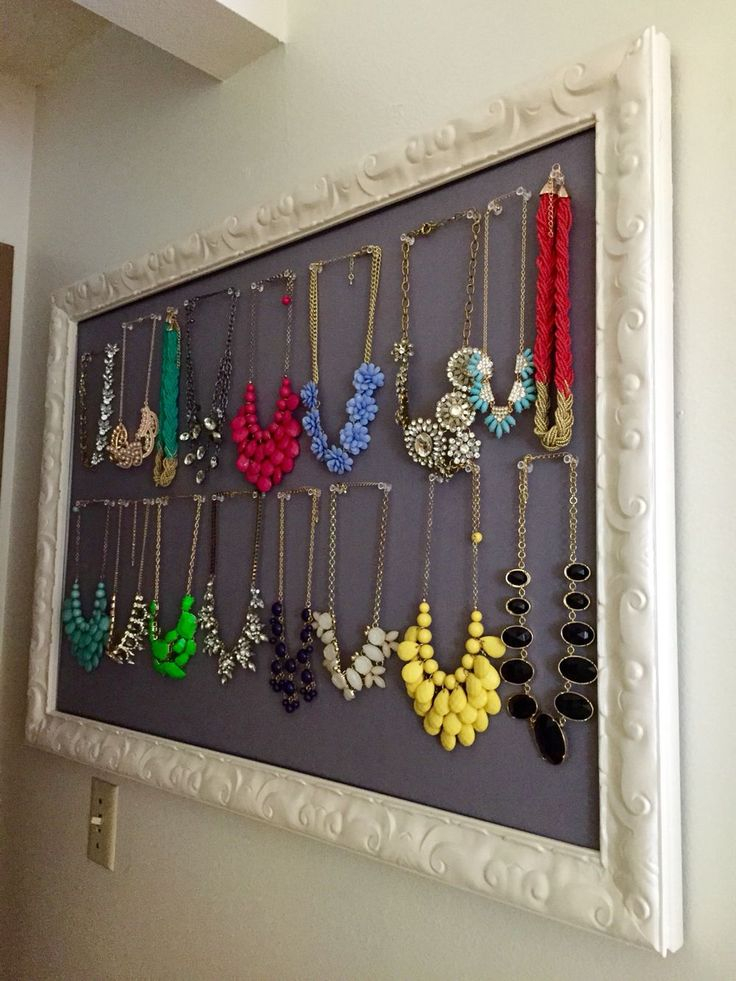 Statement necklace jewelry pin board organizer using fabric, old vintage picture frame, paint, and cork board! Easy, cheap, and cute.