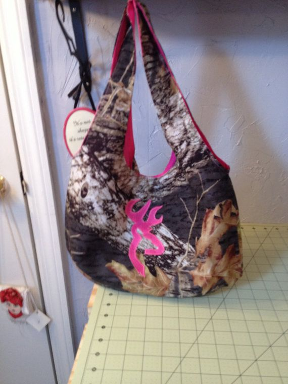 Hey, I found this really awesome Etsy listing at https://www.etsy.com/listing/165898334/pink-camo-purse-with-browning-symbol