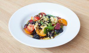 Serve as part of a summer sharing menu: tomato and berry salad with breadcrumbs and herbs.