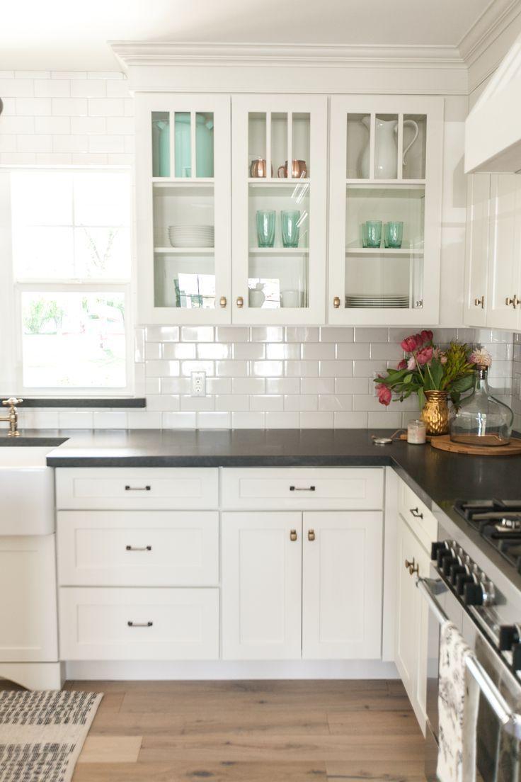 Black And White Kitchen Backsplash White Kitchen Cabinets Black Countertops And White Subway Tile Wi Kitchen Renovation Kitchen Remodel Kitchen Cabinets Decor