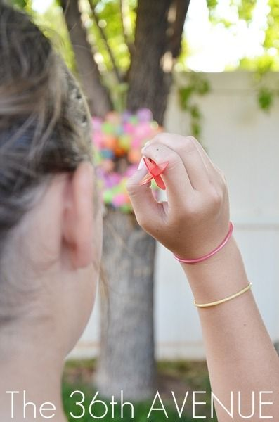 A funm summer idea for older kids.  Fill water balloons up and pin them to a wreath.  Have kids throw darts to pop the balloons.