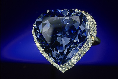 The remarkable Blue Heart Diamond was found at the Premier Mine, South Africa in 1908. This 30.62 carat heart-shaped, brilliant cut blue diamond was faceted by French jeweler Atanik Eknayan of Paris in 1909-1910 from a 100.5 carat piece of rough. The Smithsonian is celebrating 100 years since the cutting of the Blue Heart Diamond – its 100th anniversary, 1910-2010.