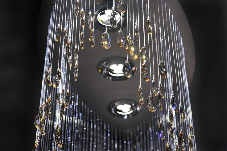 Modern chandelier made of crystals hanging on sparkling fiber optics. Night mode. MADE WITH SWAROVSKI ELEMENTS.