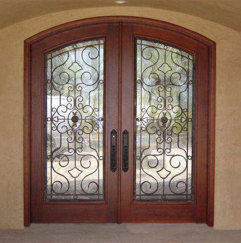 Custom wood and iron doors doors by design daphne for Kail wood doors designs