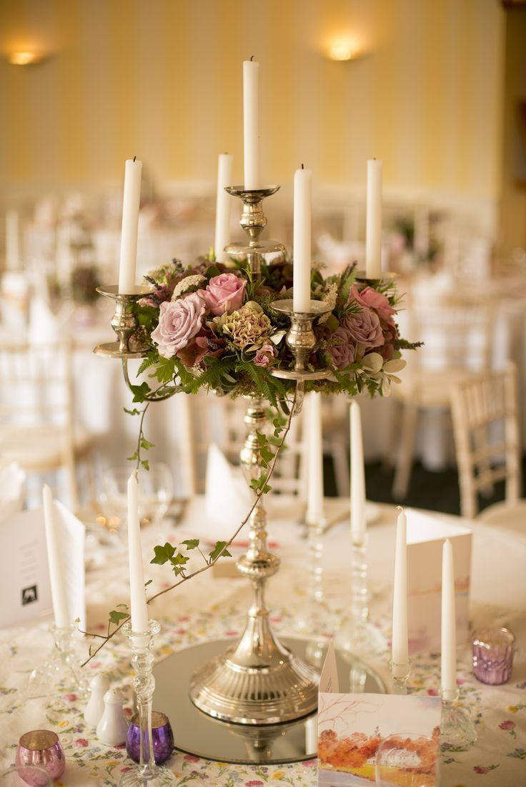 guest Table Floral candelabra at Dee's Vintage style wedding at Innishannon House Hotel. Cork Flowers and styling by Jill at Wild www.wild.ie photo by Simon Harper